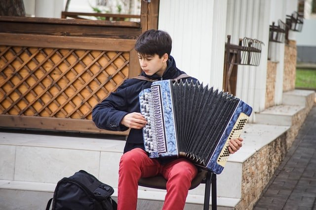 Teen Playing An Accordian